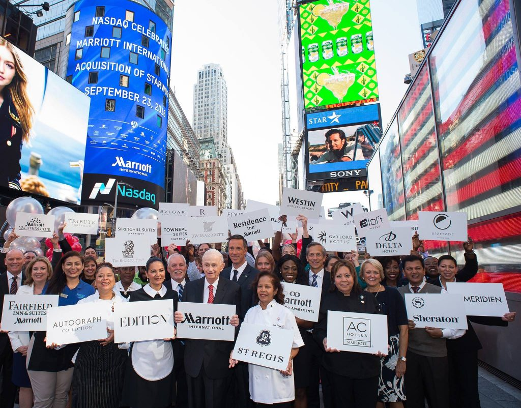 Bill Marriott, executive chairman and chairman of the Board, and Arne Sorenson, president and CEO, Marriott International, join associates in New York City's Times Square to celebrate the merger.
